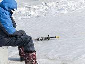 image of ice fishing  - Winter fishing on ice of the frozen sea gulf - JPG