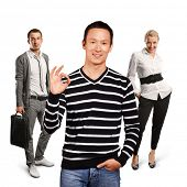 Teamwork concept. Asian man in striped pullovert, showing OK sign