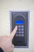 Human Finger Pushing Button Of House Intercom