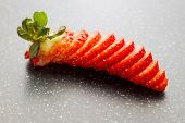 image of granite  - closeup of sliced cutting strawberry on granite board - JPG