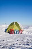 foto of tent  - Tent stands in the mountains in the snow - JPG