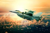 Military Jet Plane With Missile Weapon Flying Against Sunset Sky Use For World Battle And Political