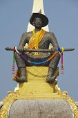 Statue of the King Chao Anouvong in front of the Pha That Luang stupa in Vientiane Laos.