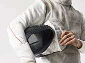 stock photo of competing  - fencer with mask under arm ready to compete - JPG