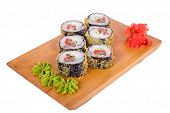 Japanese cuisine serving, roll warm sushi on wooden board isolated white background