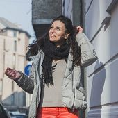 Beautiful Young Brunette Posing In The City Streets