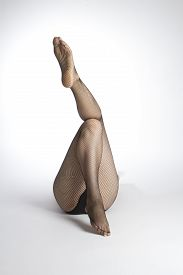 pic of fishnet stockings  - a legs crossed  woman with fishnet stocking - JPG