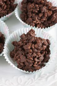 stock photo of crispy rice  - Chocolate covered crispy rice cakes a favorite childrens treat - JPG