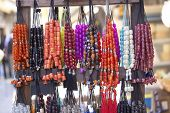 image of rosary  - Colorful rosaries on the stand close up - JPG