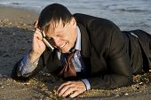 miserable crying businessman on cellphone