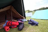 foto of sleeping bag  - tent and backpacks and sleeping bags outside - JPG
