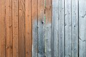 foto of wooden fence  - Half painted red wooden fence as background - JPG