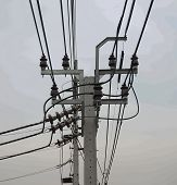 foto of power transmission lines  - Electric poles located along street power cable connection to home lines - JPG