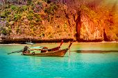 stock photo of phi phi  - Traditional wooden boat in a tropical bay on Koh Phi Phi Island - JPG