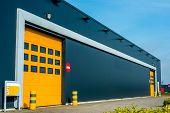 picture of roller shutter door  - Modern business unit with shutter yellow door - JPG