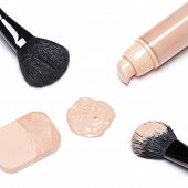 picture of foundation  - Closeup of foundation with open jar makeup brushes and cosmetic sponge on white background - JPG
