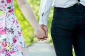 picture of fiance  - Young couple in love holding hands in summer park - JPG