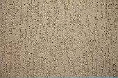 picture of building relief  - beige wall background with an abstract relief pattern closeup - JPG