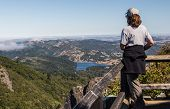 picture of marines  - Female looking at the Marin Lakes from top of Mt - JPG