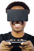 foto of controller  - Black male wearing a virtual reality headset and controller on white background - JPG