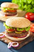 stock photo of burger  - burger with beef patty lettuce onion tomato ketchup - JPG