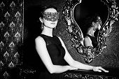 image of masquerade  - Beautiful mysterious stranger girl in venetian mask - JPG