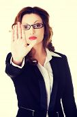 image of taboo  - Serious business woman making stop sign - JPG