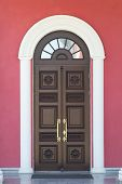 foto of building relief  - Brown wooden door on a building facade - JPG
