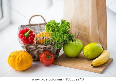 cooking, diet, vegetarian food and healthy eating concept - close up of basket with fresh ripe juicy