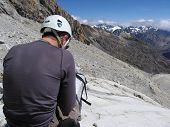 mountaineer looking map on the  Alpamayo glacier