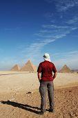 Man look on pyramid