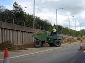 Dumping Earth With  A Dumper Truck In Road Works