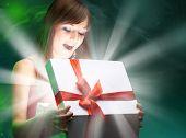 Beautifull girl opening x-mass magic present