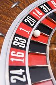 stock photo of close-up  - Close up of ball on roulette wheel with ball in number one slot - JPG