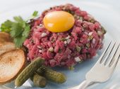 Steak Tartare with Cornichons, Croutons and an Egg Yolk