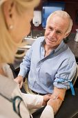 picture of blood test  - Middle Aged Man Having Blood Test Done - JPG