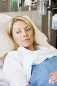Woman Lying Down In Hospital Bed