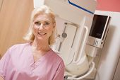 pic of mammogram  - Portrait Of A Nurse In Front Of A Mammogram Machine - JPG