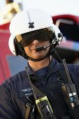 stock photo of medevac  - Portrait of paramedic standing in front of Medevac - JPG