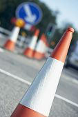 stock photo of traffic sign  - Traffic Cones Lined Up On The Side Of The Road - JPG