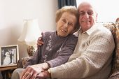 stock photo of old couple  - Loving Senior Couple Relaxing At Home - JPG