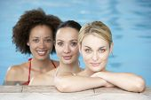 image of mixed race  - Three Female Friends In Swimming Pool - JPG