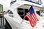NORWALK, CT - SEPTEMBER 24: American flag waving from boat at  Boat show 2011 September 24, 2011 in Norwalk, CT.