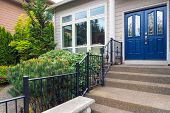 House With Blue Double Doors Concrete Steps Entry By Landscaped Front Yard Garden poster
