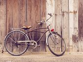 Cyclists Outdoor Lifestyle. Classic Vintage Retro Bicycle Against The Wooden Old Crack Wall At Home  poster