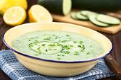 Refreshing Cold Cucumber, Yogurt, Mint And Lemon Soup In Enamel Bowl, Garnished With Cucumber Slices poster