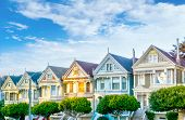 Late Afternoon Sun Light Up A Row Of Colorful Victorian Houses Known As Painted Ladies Across From A poster