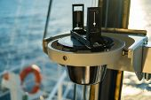 Close Up Of Nautical Marine Magnetic Compass On Yacht Or Boat With Beautiful Sunset On Background. C poster