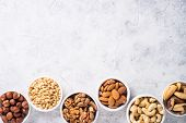 Assortment Of Nuts In Bowls. Cashew, Hazelnuts, Walnuts, Almonds, Brazilian Nuts And Pine Nuts. Top  poster