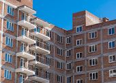 Multi-storey Building. Construction Of Multi-storey Residential Building. Windows And Balconies On T poster